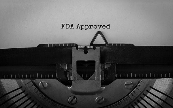 Text FDA Approved typed on retro typewriter
